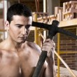 Male worker with pick axe and bricks — Stock Photo