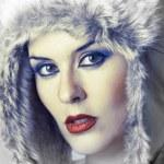 Beautiful winter woman looking — Stock Photo #9477434