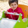Baby boy playing at park with little car — Stock Photo