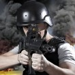 Royalty-Free Stock Photo: Person, explosion in an industry, armed police wearing bulletpro