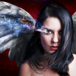 Angel angry, girl with burning eye - Stock Photo