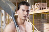Male worker with shovel and bricks — Stock Photo