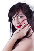 Portrait of young beautiful woman with hand on cheek — Stock Photo