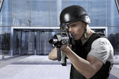 Person, defense of building, protecting a business complex — Stock Photo