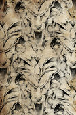 Tattoo pattern with gargoyle designs over antique paper — Stock Photo