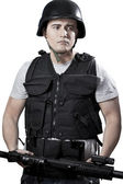 Armed police in protective cask with a gun — Stock Photo