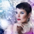 Glamorous stylish short haired woman with disco lights - Stock Photo