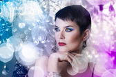 Glamorous stylish short haired woman with disco lights — Stock Photo
