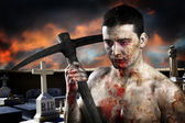 Male zombie in a cemetery, undertaker with pick axe — Stock Photo