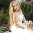 Stock Photo: Beautiful bride posing in her wedding day