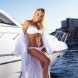 The young woman in a bathing suit has a rest on a deck of a yacht - Stock Photo