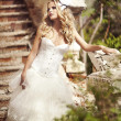 Stock Photo: A beautiful bride in the white wedding dress