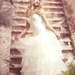 A beautiful bride in the white wedding dress — Stock Photo