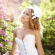 Beautiful bride in a lavender garden — Stock Photo #10629065