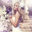 Beautiful woman with flowers of lilac. Skincare - Foto de Stock