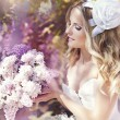 Beautiful bride in a lavender garden — Stock Photo #10629223
