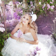 Stock Photo: Portrait of a bride with a bouquet of lilacs