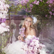 Portrait of a bride with a bouquet of lilacs — Stock Photo #10629487