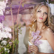 Beautiful bride in a lavender garden — Stock Photo #10629523