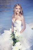 Beautiful young caucasian bride on the beach — Stock Photo