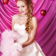 Portrait of a beautiful bride with apples on a pink background — Stock Photo