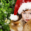 Adorable little girl wearing Santa Claus clothes — Stock Photo #8694118