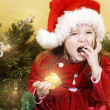 Adorable little girl wearing Santa Claus clothes — Stock Photo #8694146