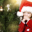 Adorable little girl wearing Santa Claus clothes — Стоковая фотография