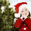 Adorable little girl wearing Santa Claus clothes — Stock Photo
