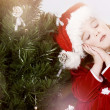 Adorable little girl wearing Santa Claus clothes — Stock Photo #8694194