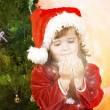 Adorable little girl wearing Santa Claus clothes — Stock Photo #8694203