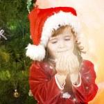 Adorable little girl wearing Santa Claus clothes — Stock Photo