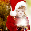 Adorable little girl wearing Santa Claus clothes — Stock Photo #8694210