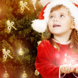 Adorable little girl wearing Santa Claus clothes — Stock Photo #8694223