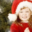 Adorable little girl wearing Santa Claus clothes — Stock Photo #8694231