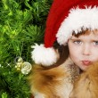 Adorable little girl wearing Santa Claus clothes — Stock Photo #8694245