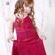 Elegant little girl in a bright pink dress — Stock Photo #8694512