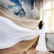 Beautiful girl in a white dress like an angel — Stock Photo