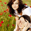 Two pretty caucasian girls in a poppy field at sunset — Stock Photo #8695233