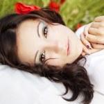 Portrait of a beautiful girl in a poppy field — Stock Photo #8695349