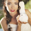 Pretty girl holding a white dove - Stock Photo