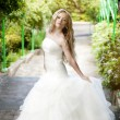 The image of a beautiful bride in a blossoming garden - Stok fotoğraf