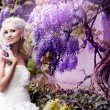 The image of a beautiful bride in a blossoming garden — Stock Photo #8695650