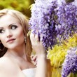 The image of a beautiful bride in a blossoming garden — Stock Photo #8695684