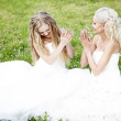 Young bride whispers to friend — Stock Photo