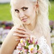 The image of a beautiful bride in a blossoming garden — Stock Photo