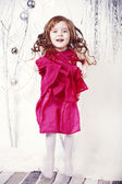 Little girl jumps on a white background — Stock Photo
