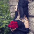 Beautiful gothic girl with roses — Stock Photo #8708461