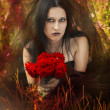 Beautiful gothic girl with roses — Stock Photo
