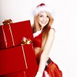 Beautiful girl in the studio with gifts for Christmas — Stock Photo #8708970